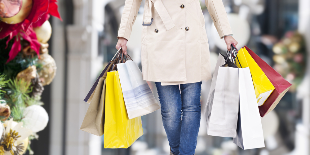 woman holding shopping bags walking