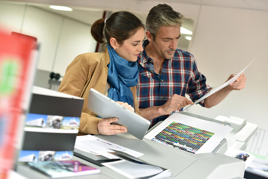 man and woman looking at print samples
