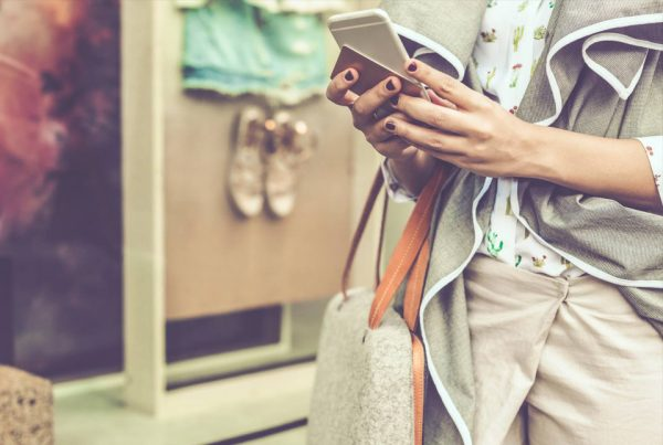 woman holding mobile phone shopping