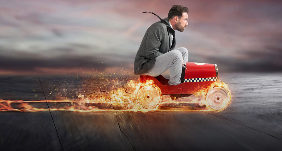 man on a toy car in flame - growth
