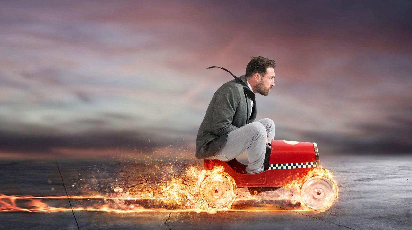 man on speedy go kart - full