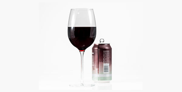 a wine glass and a can